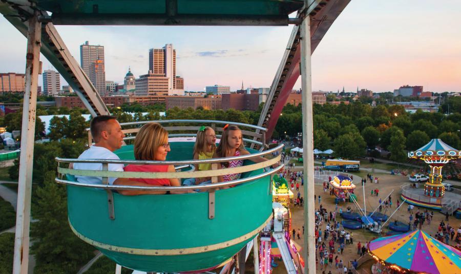 Family in Ferris Wheel at Three River Festival