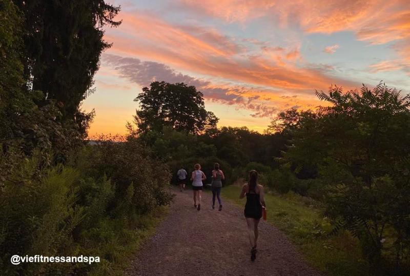 Sunset over runners in Nichols Arboretum