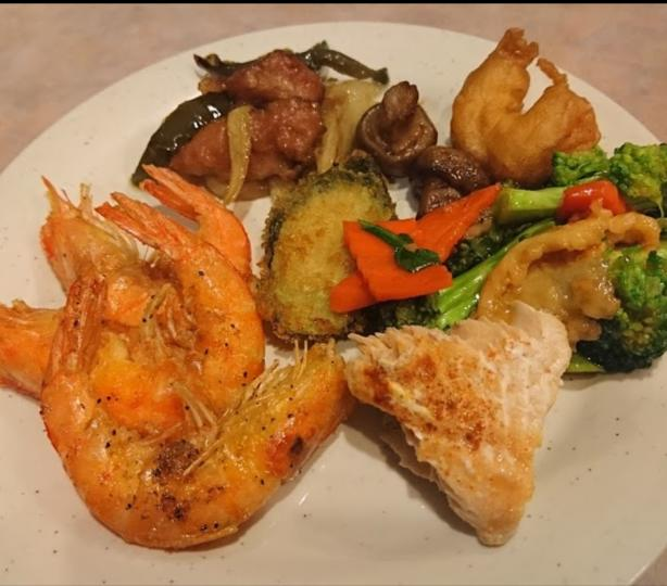 Plate full of steamed vegetables and shrimp