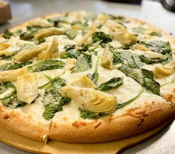 Fresh spinach, artichoke hearts and mozzarella cheese pizza