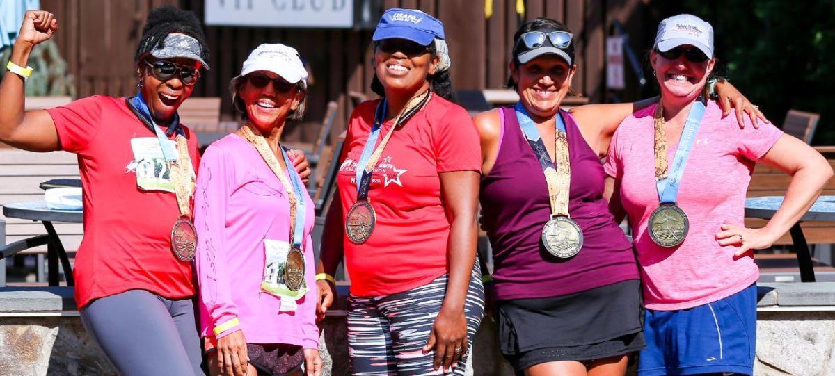 Prince William Marathon Females wearing finisher medals