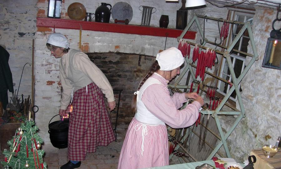 Two women making candles at Rose Hill Manor.