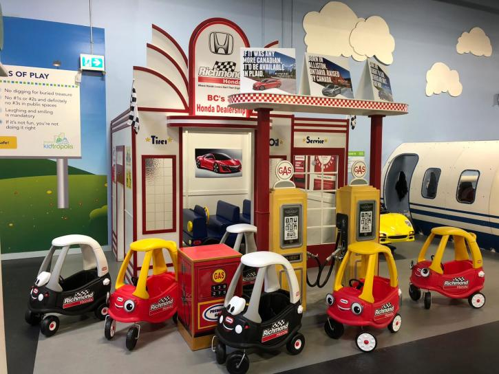 The car dealership & gas station at The World of Kidtropolis