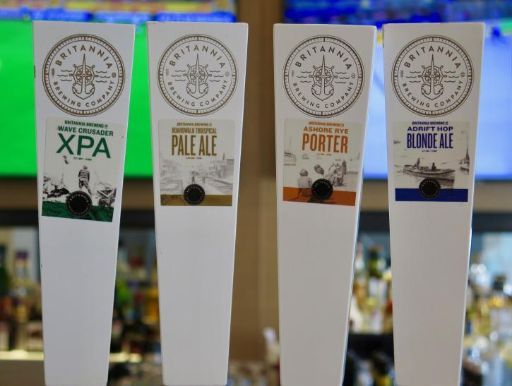 Labels on the beer taps at 75 West Coast Grill