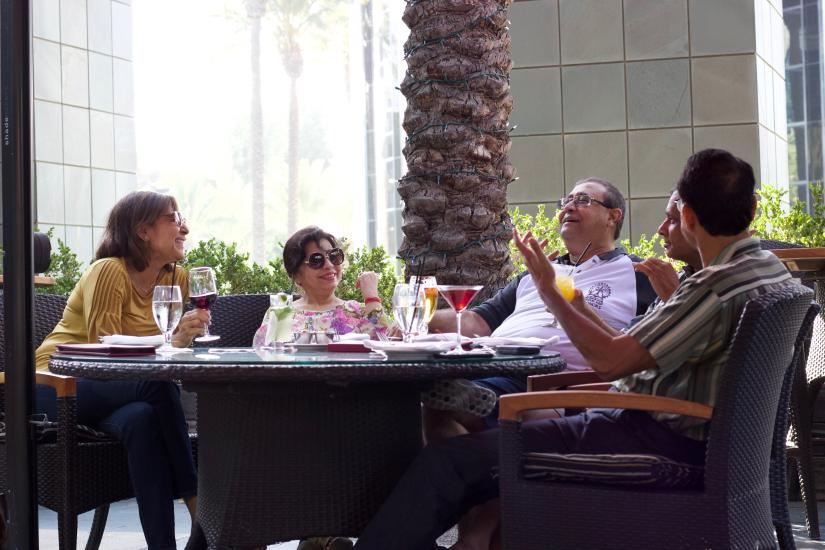 Friends enjoying happy hour at Bistango in Irvine