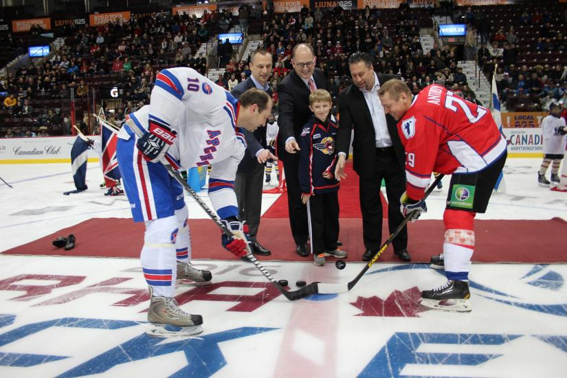 The puck drop at a past Feature game