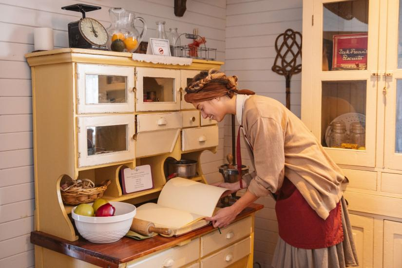 Reading a recipe in the Manager's House at Britannia Shipyards