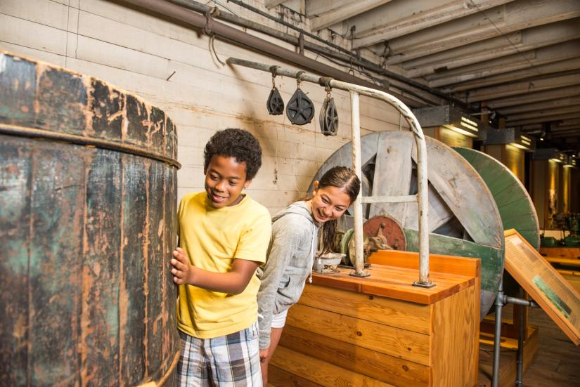 Two kids exploring the Gulf of Georgia Cannery