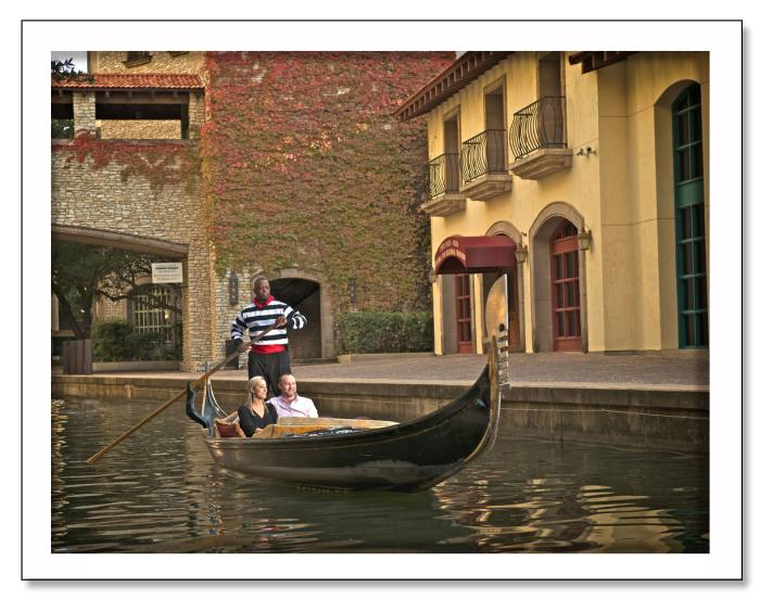Visitors enjoy a gondola ride down a Mandalay Canal waterway.
