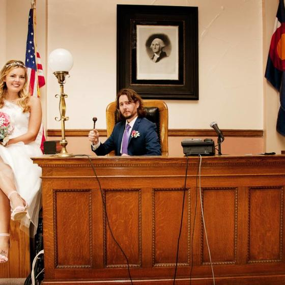 Bride_and_Groom_sitting_at_judges_bench_by_durango_photographers