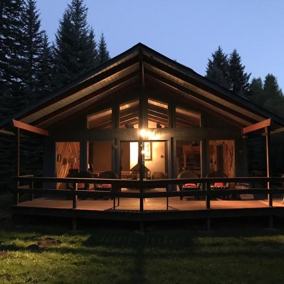 Creekside vacation home at night