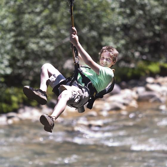 Young Soaring guest enjoys zip line across Animas