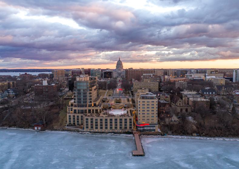 An aerial shot of The Edgewater hotel, with the State Capitol in the background