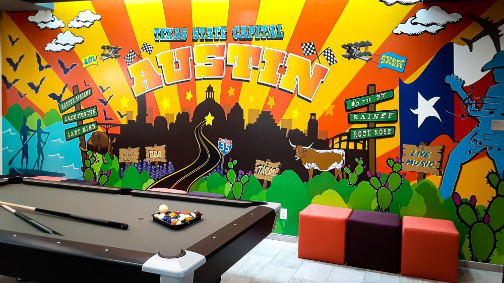 Pool table and Mural. Courtesy of Tru by Hilton Austin Airport
