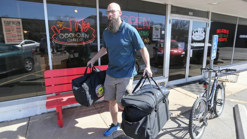 Man with a beard providing Wichita2go Food Delivery service