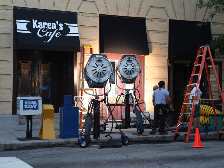 Film crew outside set of Karen's Cafe