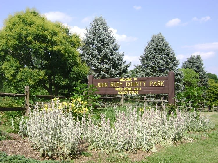 Welcome To John Rudy County Park Sign