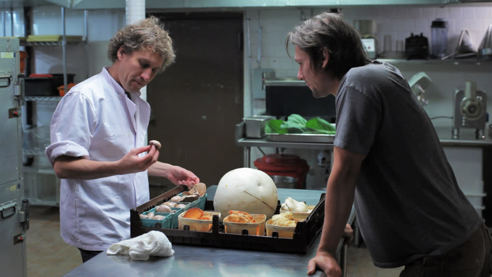 Now, Forager film still with two men in kitchen with ingredients