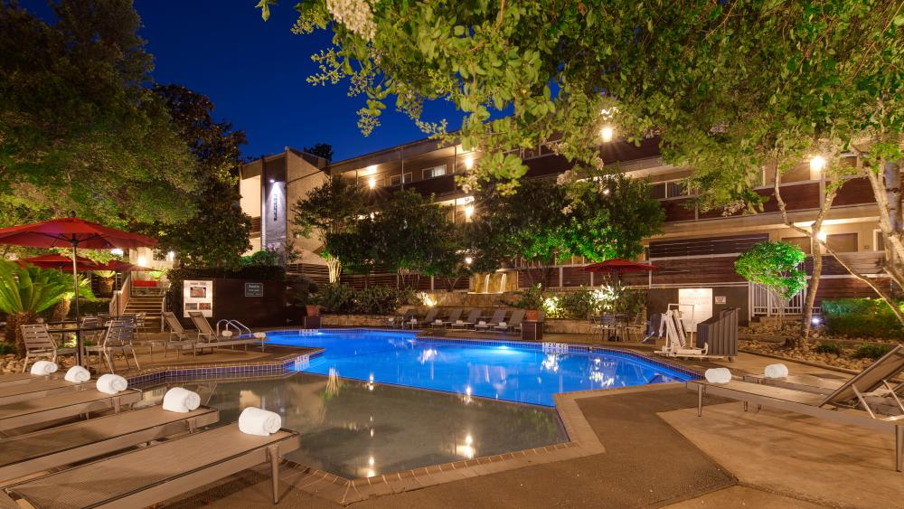 Pool at night at Aiden by Best Western Austin City Hotel in Austin Texas