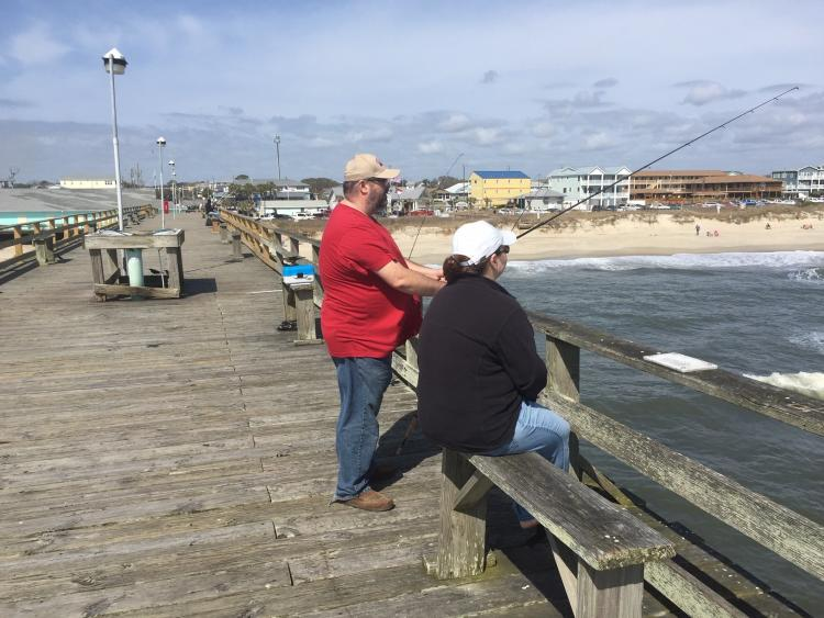 A couple fishing off the Kure Beach Fishing Pier in North Carolina