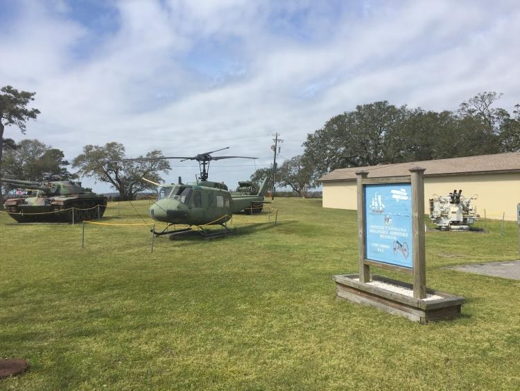 A tank, helicopter and anti-air gun at the NC Military Museum in Kure Beach