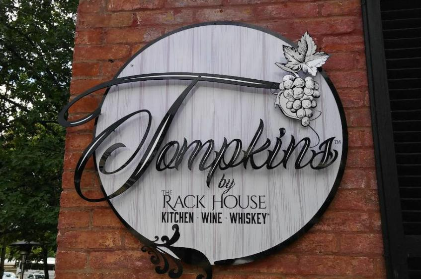 Tompkins by the Rack House - Logo