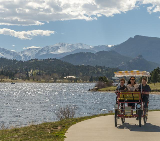 Family Pedal Cart Ride Along Lake Estes Trail