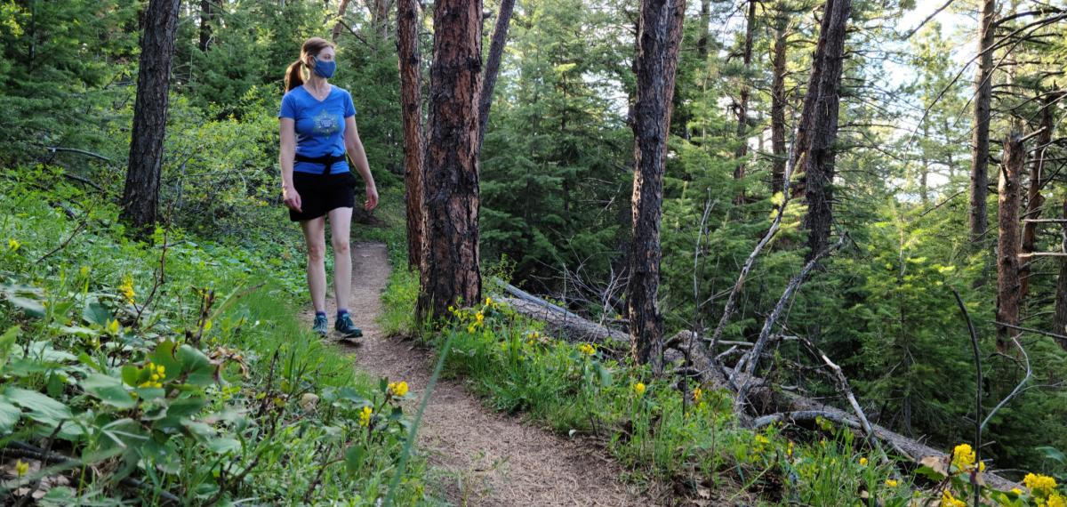 Woman hiking with a mask in Boulder