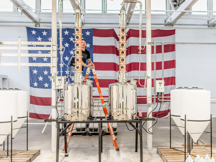 American flag and the still at InStill Distillery in Clayton, NC.