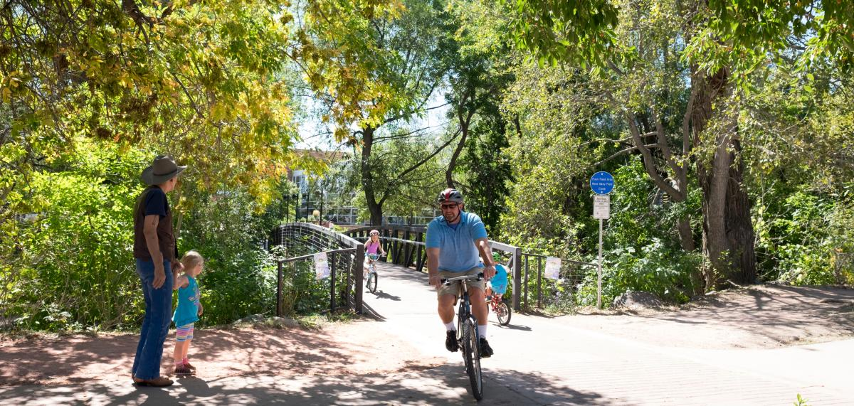 Families biking and walking on Boulder Creek Path