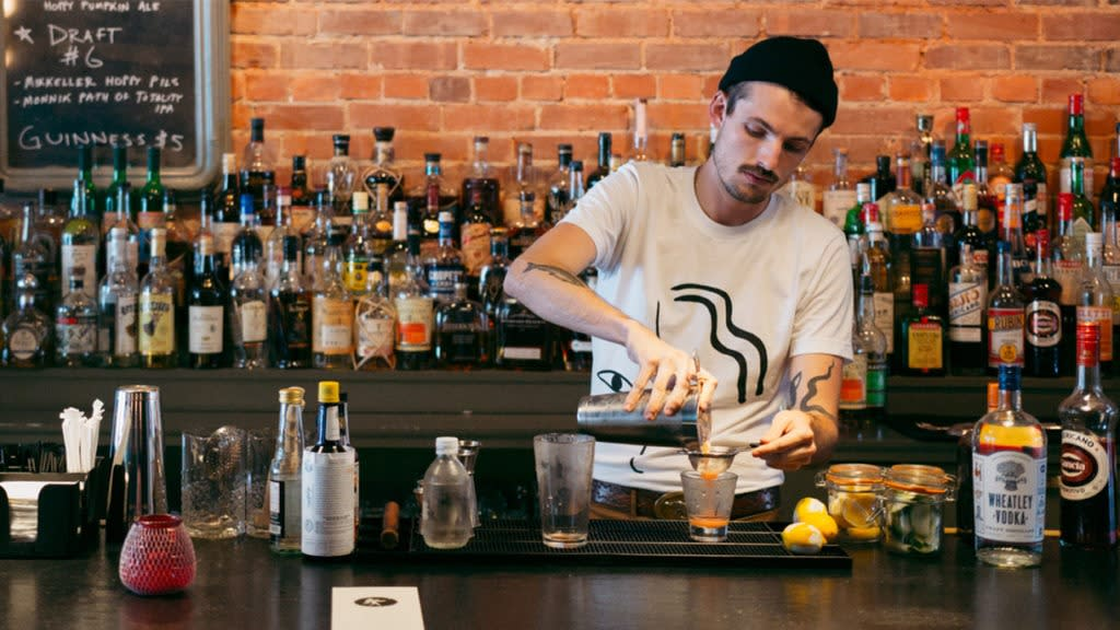 A bartender crafts a cocktail at Bar Ona.