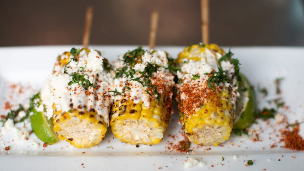 Three elotes plated elegantly from Corto Lima.
