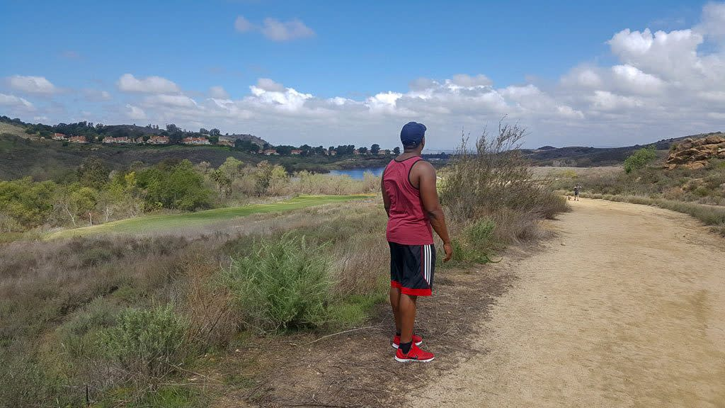 Man Looking Out Over Hills