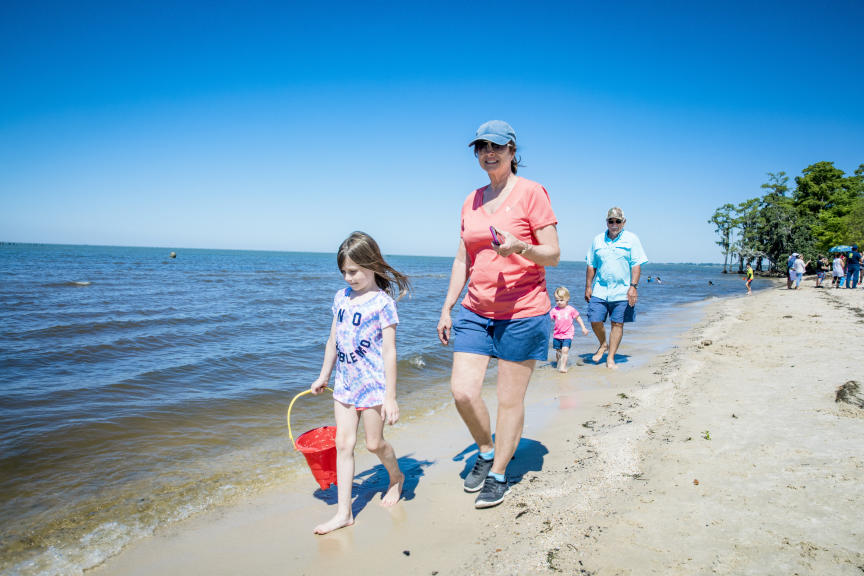 Family walking on beach at Fontainebleau State Park
