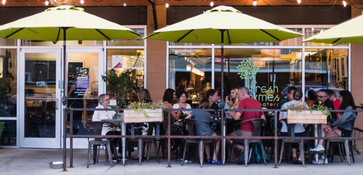 Customers eating at Fresh Thymes outdoor dining area