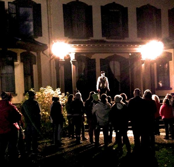 Haunted History Tour at the Seward House Museum - crowd around tour guide on steps to the museum