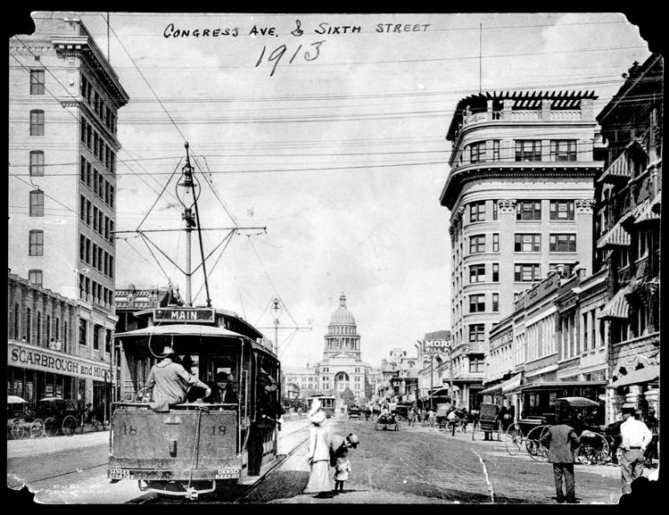 looking north on Congress Avenue at Sixth Street in 1913 with trolley car in front