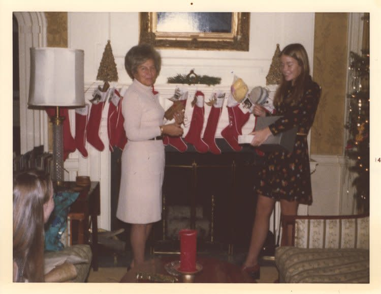 Governors' Girls standing in front of a fireplace with stockings