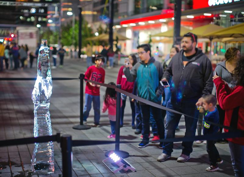 Visitors enjoy an ice sculpture during Frostival at Discovery Green