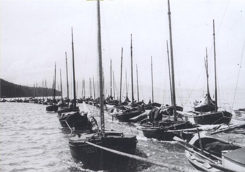 Skiffs being towed