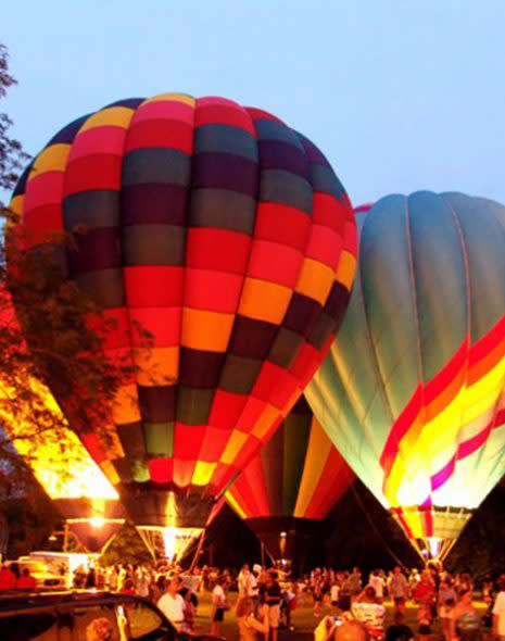Multi colored hot air balloons glowing with light at Coney Island