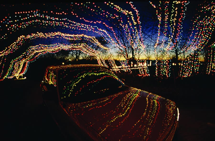 car under winter wonderland lights