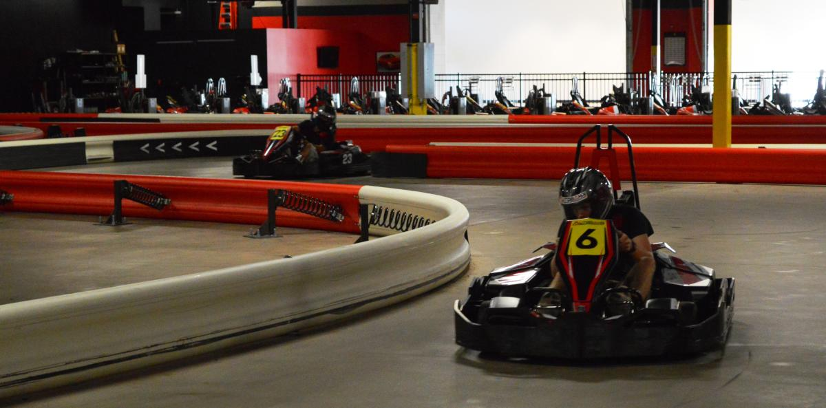 Interior picture of an individual driving on the track at autobahn indoor raceway.