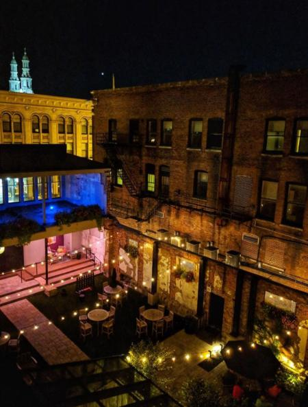 aerial view of the patio at hotel covington in the dark with lights strung across