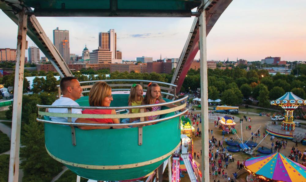 Family in Ferris Wheel at Three River Festival
