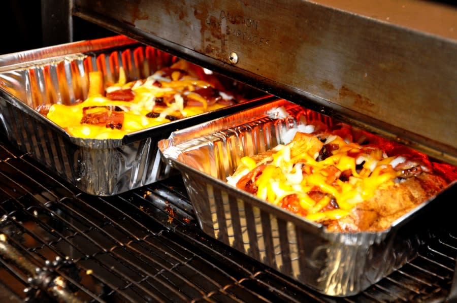 Baked potatoes coming out of the oven
