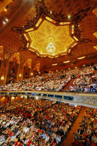 View of packed audience sitting inside the stunning, highly embellished Ohio Theatre
