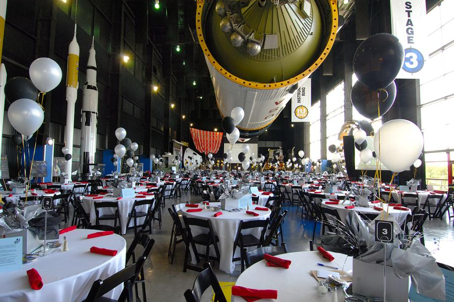 Space and Rocket Center Meeting Room With Balloons and Round Tables