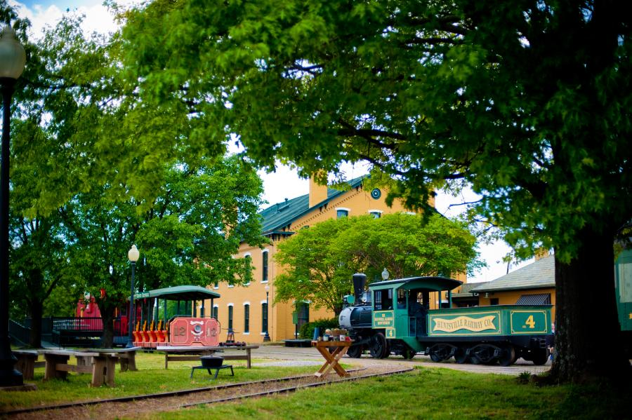 An antique railcar sits quietly at the historic Huntsville Depot.