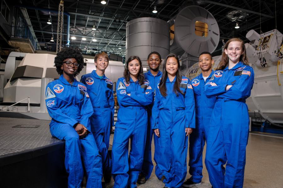 Group Of Kids In Astronaut Uniforms At Space Camp